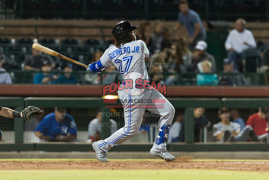 Surprise Saguaros third baseman Vladimir Guerrero Jr. (27), of the Toronto Blue Jays organization, follows through on his swing during an Arizona Fall League game against the Scottsdale Scorpions at Scottsdale Stadium on October 15, 2018 in Scottsdale, Arizona. Surprise defeated Scottsdale 2-0. (Zachary Lucy/Four Seam Images)