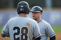 Campbell Camels head coach Justin Haire (3) chats with Matthew Barefoot (28) during the game against the High Point Panthers at Williard Stadium on March 16, 2019 in  Winston-Salem, North Carolina. The Camels defeated the Panthers 13-8. (Brian Westerholt/Four Seam Images)