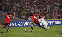 Egypt's Salah Soliman (2), left, and Ahmed Hegazy (6) make a get away with the ball from Costa Rica's Marcos Urena (7) during the FIFA Under 20 World Cup Round of 16 match between Egypt and Costa Rica at the Cairo International Stadium on October 06, 2009 in Cairo, Egypt.