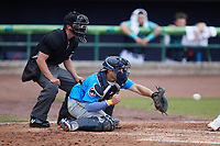 Myrtle Beach Pelicans catcher Raymond Pena (35) receives a pitch as home plate umpire Mike Mackey looks on during the game against the Lynchburg Hillcats at Bank of the James Stadium on May 22, 2021 in Lynchburg, Virginia. (Brian Westerholt/Four Seam Images)