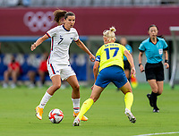 TOKYO, JAPAN - JULY 21: Tobin Heath #7 of the USWNT is defended by Caroline Seger #17 of Sweden during a game between Sweden and USWNT at Tokyo Stadium on July 21, 2021 in Tokyo, Japan.