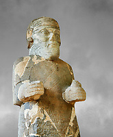 Pictures & images of the South Gate Hittite sculpture statue of Hittite Storm God Tarhunzas ( Tarḫunz Tarḫunna or in Hurrian Teshub or in Phoenician Baal Krntrys ). 8th century BC. Karatepe Aslantas Open-Air Museum (Karatepe-Aslantaş Açık Hava Müzesi), Osmaniye Province, Turkey. Against grey art background