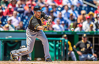 25 July 2013: Pittsburgh Pirates pitcher A.J. Burnett lays down a bunt against the Washington Nationals at Nationals Park in Washington, DC. The Nationals salvaged the last game of their series, winning 9-7 ending their 6-game losing streak. Mandatory Credit: Ed Wolfstein Photo *** RAW (NEF) Image File Available ***
