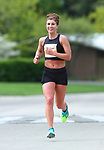 April 22, 2017 - Champaign, IL - Tuscola High School alum Rachel Brewer finishes up the 23rd mile of her race on the way to the women's title at the 2017 Illinois Marathon. Brewer, who won the title with a time of 2:47:26, was 13th overall out of 1,215 finishers. PhotoNews Media/Clark Brooks