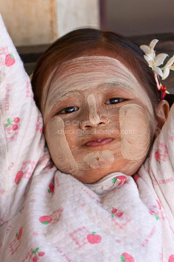 Myanmar, Burma.  Little Girl Wearing Thanaka Paste as a Cosmetic Sunscreen,  Shwezigon (Shwezegon)  Pagoda, Nyaung Oo, near Bagan.