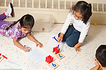 Education preschool 4 year olds activity using peg board math and numbers and writing letters, one girl counting