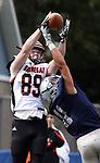 Barnegat's # 89 (left) Sean Morris gets high enough to grab a Brian Finucan (not seen) thrown pass  behind the defense of Manasquan's # 11 James Pendergist as Barnegat High School takes on Manasquan High School in a varsity football game in Manasquan on Saturday September 30, 2017.<br /> (Mark R. Sullivan | For NJ Advance Media)