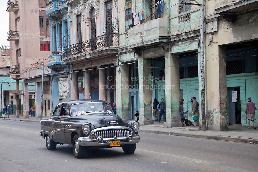 Cuba, Havana.  Early Morning Central Havana Street Scene, 1953 Buick.