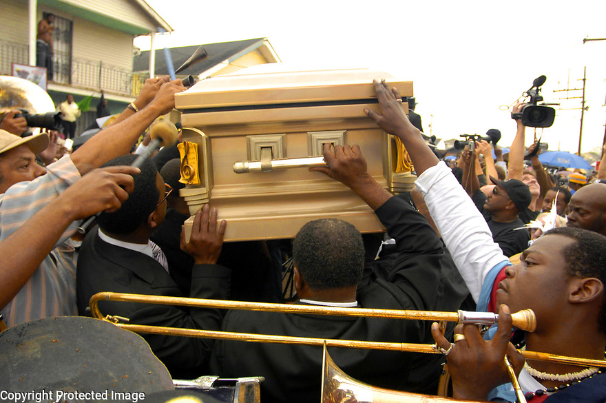 Mourners carry the casket of Dinerral Shavers, 25, who died from a gunshot to the back of his head in New Orleans, Sat., Jan. 6, 2007. Shavers was the snare drummer for the Hot 8 Brass Band and the music teacher at L.E. Rabouin High School, where he had recently begun the school's first-ever marching band. He was killed by a teen who was trying to shoot his stepson. <br /><br />(AP Photo/Cheryl Gerber)