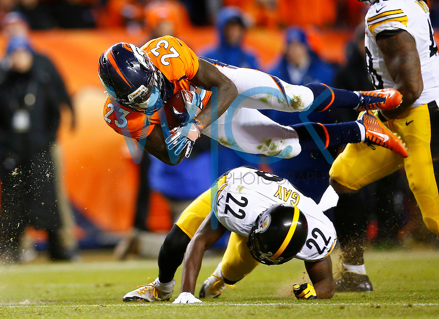 Ronnie Hillman #23 of the Denver Broncos is upended by William Gay #22 of the Pittsburgh Steelers while carrying the ball in the second half during the AFC Divisional Round Playoff game at Sports Authority Field at Mile High on January 17, 2016 in Denver, Colorado. (Photo by Jared Wickerham/DKPittsburghSports)