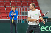 The Hague, The Netherlands, September 11, 2017,  Sportcampus , Davis Cup Netherlands - Chech Republic, training, Thiemo de Bakker (NED) with in the background Captain Paul Haarhuis (NED)<br /> Photo: Tennisimages/Henk Koster