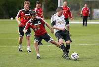 Pictured L-R: Richie Buchanan against Gareth Vincent. Tuesday 06 May 2014<br /> Re: Members of the local press play football against Swansea City FC coaches and members of staff at the Club's training ground in Fairwood, south Wales.