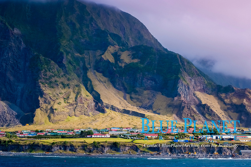 The settlement of Edinburgh of the Seven Seas, on the Island of Tristan Da Cunha. Rare unusual image. South Atlantic Ocean MORE INFO: Tristan Da Cunha is claimed to be the most remote inhabited island in the world, lying 2,816 kilometres (1,750 mi) from the nearest land, South Africa, and 3,360 kilometres (2,088 mi) from South America.