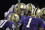 Jake Locker (#10), University of Washington quarterback, calls the play in the huddle during the Huskies Pac-10 conference football game against arch-rival Washington State at Husky Stadium in Seattle, Washington, on November 28, 2009.  Washington shut out the Cougars in their annual Apple Cup battle, 30-0.