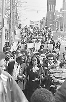 Coretta Scott King, arm-in-arm with entertainer Ben Vereen, left, and David Smith, leads a march through Atlanta on Sunday, March 16, 1981 honouring the 22 missing and murdered children of Atlanta. About 2500 people participated in the March and a rally. (AP Photo/Gary Gardiner)