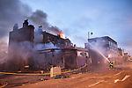 © Joel Goodman - 07973 332324 . 07/08/2011 . London , UK . Fire crews on Tottenham High Street . Overnight rioting and looting in Tottenham , following a protest against the police shooting of Mark Duggan . Photo credit : Joel Goodman