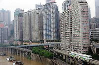 Chongqing metro train across high density apartments. .02 Aug 2009
