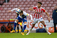19th December 2020; Bet365 Stadium, Stoke, Staffordshire, England; English Football League Championship Football, Stoke City versus Blackburn Rovers; Barry Douglas of Blackburn Rovers wins the header in front of Jacob Brown of Stoke City