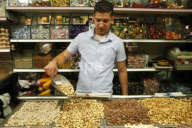 A Palestinian man sells nuts at the market of Khan al-Zeit gate, near al-Aqsa mosque in Jerusalem's Old City, June 26, 2013. Photo by Saeed Qaq