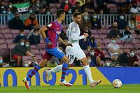 20th September 2021; Nou Camp, Barcelona, Spain; La Liga football league;  FC Barcelona versus Granada;   Antonio Pjuertas and Sergio Busquets chase a through ball