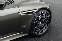 """BNPS.co.uk (01202 558833)<br /> Pic: SilverstoneAuctions/BNPS<br /> <br /> Massive 21"""" OHMSS wheels.<br /> <br /> Stunning Aston Martin 'James Bond' supercar with only 45 miles on the clock - yours for £300,000.<br /> <br /> A limited edition Aston Martin that was built to mark the 50th anniversary of one of the most popular James Bond movies has emerged for sale for around £300,000.<br /> <br /> The DBS Superleggera was one of just 50 created last year to commemorate five decades since the release of On Her Majesty's Secret Service.<br /> <br /> The movie, which came out in 1969, was the first in the franchise not to feature Sean Connery and instead starred George Lazenby as 007."""