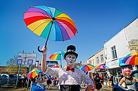 Pictured: A young man takes part in the Pride parade as it travels through the streets of Swansea, Wales, UK. Saturday 05 May 2018<br /> Re: Spring Pride has brought a celebration of colour to the streets of Swansea in Wales, UK.<br /> Rainbow flags were flown in support of the LGBT community at the event, which is designed to raise awareness and is open to anyone to take part in.