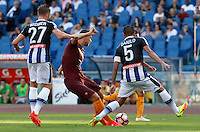 Calcio, Serie A: Roma vs Udinese. Roma, stadio Olimpico, 20 agosto 2016.<br /> Roma's Edin Dzeko, center, is challenged by Udinese's Silvan Widmer, left, and Danilo during the Italian Serie A football match between Roma and Udinese at Rome's Olympic stadium, 20 August 2016. Roma won 4-0.<br /> UPDATE IMAGES PRESS/Riccardo De Luca