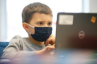 Liam Drenning, 7, works on his laptop at the Boys and Girls Club of Western Pennsylvania in the Lawrenceville neighborhood on Friday February 19, 2021 in Pittsburgh, Pennsylvania. (Photo by Jared Wickerham/Pittsburgh City Paper)