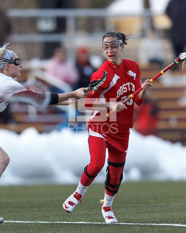 Boston University midfielder Kristen Mogavero (26)..Boston College (white) defeated Boston University (red), 12-9, on the Newton Campus Lacrosse Field at Boston College, on March 20, 2013.