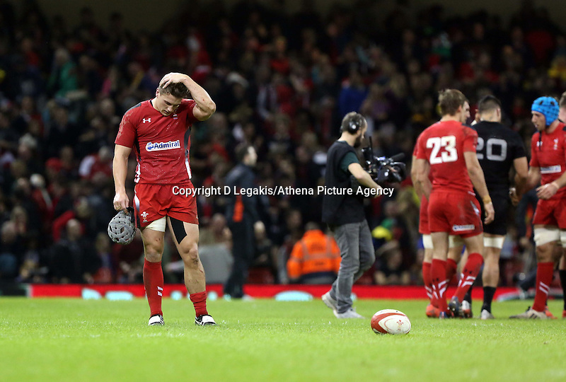 Pictured: A dejected Jonathan Davies of Wales (L) after the final whistle Saturday 22 November 2014<br /> Re: Dove Men Series 2014 rugby, Wales v New Zealand at the Millennium Stadium, Cardiff, south Wales, UK.
