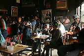 New Orleans, Louisiana.February 27, 2006..Lundi Gras - monday Gras is celebrated in the 7th ward at Nick's Next Stop lounge with a free open grill for everyone who stops by.