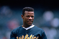 OAKLAND, CA - Rickey Henderson of the Oakland Athletics stands on the field during a game at the Oakland Coliseum in Oakland, California in 1995. (Photo by Brad Mangin)