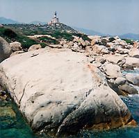 """Isola dei Cavoli, Capo Carbonara (Cagliari). Un enorme masso di granito e il faro --- Isola dei Cavoli (""""Island of Cabbage""""), at Cape Carbonara (Cagliari). A huge rock of granite and the lighthouse"""