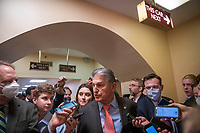 United States Senator Joe Manchin III (Democrat of West Virginia) is surrounded by reporters as he makes his way through the Senate subway during a vote at the US Capitol, in Washington, DC, Wednesday, July 21, 2021. Credit: Rod Lamkey / CNP /MediaPunch