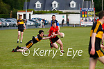 Caolim Teahan for Glenbeigh/Glencar powers through the challenge of Dr Crokes man Neil O'Shea in their first round of the Div 2 County League.