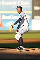 Jeffeson Medina #27 of the Everett AquaSox delivers a pitch during a game against the Tri-City Dust Devils at Everett Memorial Stadium in Everett, Washington on July 28, 2014. Tri-City defeated Everett 6-5 in 11 innings.  (Ronnie Allen/Four Seam Images)