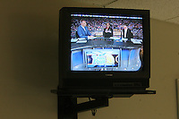 6 April 2008: ESPN commentator Trey Wingo (left), Stanford Cardinal Candice Wiggins (center), and head coach Tara VanDerveer (right) on ESPN's halftime show on a television in the media workroom during Stanford's 82-73 win against the Connecticut Huskies in the 2008 NCAA Division I Women's Basketball Final Four semifinal game at the St. Pete Times Forum Arena in Tampa Bay, FL.