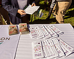 October 26, 2017. Raleigh, North Carolina.<br /> <br /> Garden dedication attendees grabbed information pamphlets about the new plants.  <br /> <br /> A new garden designed by Ben Skelton containing native Plants For Birds was dedicated at the North Carolina Executive Mansion.