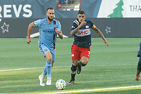 FOXBOROUGH, MA - SEPTEMBER 19: Maxime Chanot #4 of New York City FC brings the ball forward with Gustavo Bou #7 of New England Revolution in pursuit during a game between New York City FC and New England Revolution at Gillette on September 19, 2020 in Foxborough, Massachusetts.