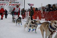 Lacey Hart of Livingston, MT leaves the start line of the 2009 Junior Iditarod on Knik Lake on Saturday Februrary 28, 2009.