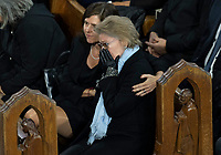 Chantal Renaud, wife of former Quebec premier Bernard Landry, is consoled by his daughter Pascale during funeral services in Montreal on Tuesday, November 13, 2018. THE CANADIAN PRESS/Paul Chiasson