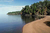Bathers on beach at Gooseberry Falls State Park near Two Harbors. Two Harbors Minnesota USA Lake Superior.