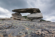 Rock cairn along the Baldface Circle Trail in the White Mountains, New Hampshire during the summer months.