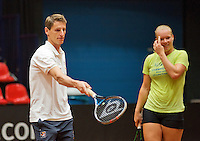 April 15, 2015, Netherlands, Den Bosch, Maaspoort, Fedcup Netherlands-Australia, Training session Dutch team, Kiki Bertens and Captain Paul Haarhuis <br /> Photo: Tennisimages/Henk Koster