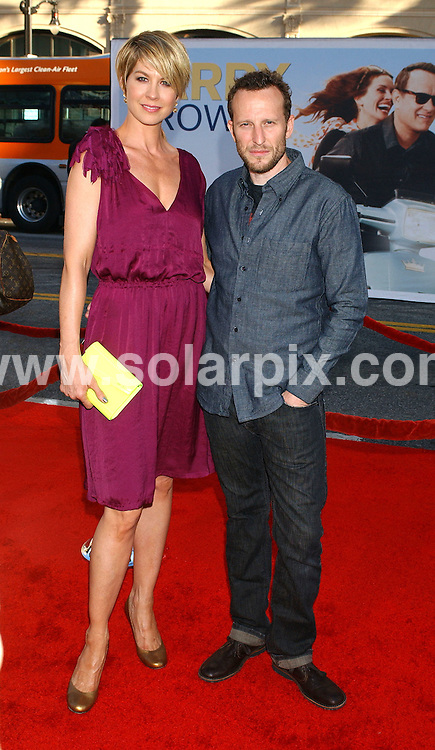 **ALL ROUND PICTURES FROM SOLARPIX.COM**                                 **NO SYNDICATION IN USA** .Premiere of new movie, Larry Crowne at the Graumans Chinese Theatre in Hollywood, Ca. on June 27, 2011.                     .This pic:     Jenna Elfman & husband                                                                                      JOB REF:    13635    GLS       DATE:    28.06.11                                                         **MUST CREDIT SOLARPIX.COM OR DOUBLE FEE WILL BE CHARGED**                                                                        **MUST NOTIFY SOLARPIX OF ONLINE USAGE**                 **CALL US ON: +34 952 811 768 or LOW RATE FROM UK 0844 617 7637**