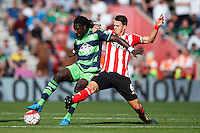 Bafetimbi Gomis and Jose Fonte during the Barclays Premier League match between Southampton v Swansea City played at St Mary's Stadium, Southampton
