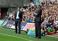 Saturday 28 September 2013<br /> Pictured L-R: Managers Michael Laudrup of Swansea and Arsene Wenger of Arsenal. <br /> Re: Barclay's Premier League, Swansea City FC v Arsenal at the Liberty Stadium, south Wales.