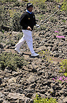 JEJU, SOUTH KOREA - APRIL 24:  Chapchal Nirat of Thailand walks over volcanic rocks on the 9th hole during the Round Two of the Ballantine's Championship at Pinx Golf Club on April 24, 2010 in Jeju island, South Korea.  Photo by Victor Fraile / The Power of Sport Images