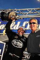 Nov. 13, 2011; Pomona, CA, USA; NHRA top fuel dragster driver Del Worsham (left) celebrates with NHRA president Tom Compton after clinching the world championship at the Auto Club Finals at Auto Club Raceway at Pomona. Mandatory Credit: Mark J. Rebilas-.