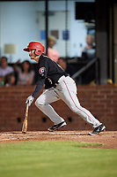 Chattanooga Lookouts center fielder Tanner English (9) follows through on a swing during a game against the Mobile BayBears on May 5, 2018 at Hank Aaron Stadium in Mobile, Alabama.  Chattanooga defeated Mobile 11-5.  (Mike Janes/Four Seam Images)